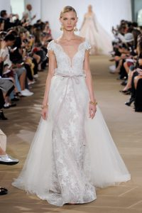 modern chic wedding dress with cape by Ines di Santo
