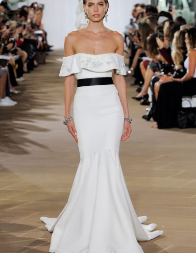 fitted modern off the shoulder wedding dress by Ines di Santo